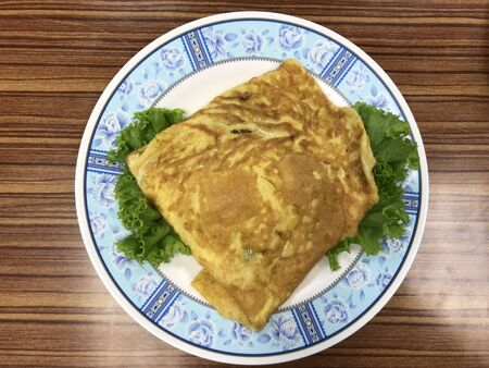 Thai style pork omelette on the decoration disc by vegetable Stock fotó