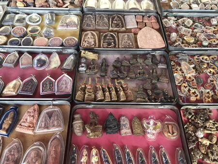 Uthong District, Suphan Buri Province / Thailand - October 13 2019: Images of framed Buddha pendant are arranged for sale for those interested to buy to pay respect Standard-Bild