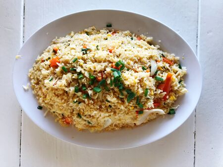 The photos on the top of the plate include crab fried rice placed on a white wooden floor, Zdjęcie Seryjne