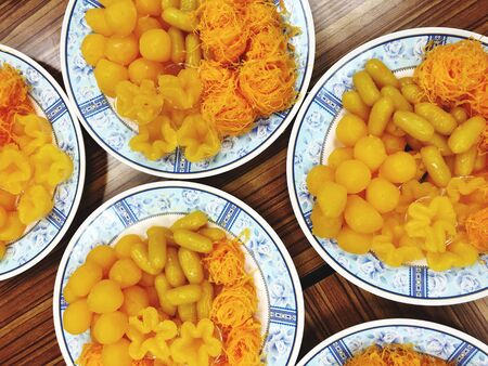 Thai desserts consist of Foi Thong, Thong Loi Thong, Yoi Thong, prepared on a plate for use in worshiping or auspicious ceremonies