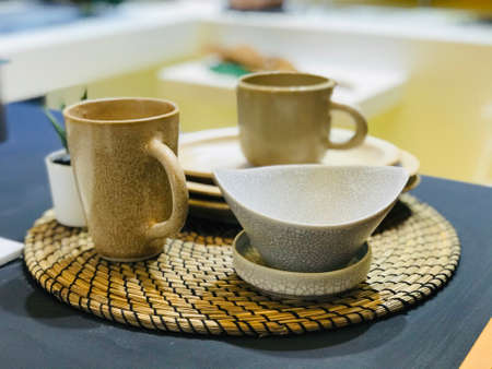 Coffee mugs and cups are beautifully arranged in the kitchen or dining room