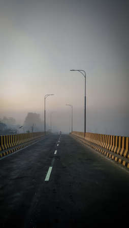 A beautiful architecture of Bridge on the river under lovely blue sky. I captured this image from Tulshikhali bridge , Bangladesh, Asia