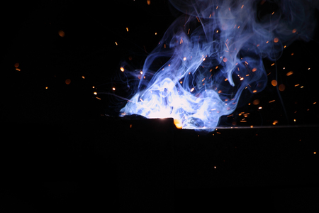 Metal Welding with sparks and smoke