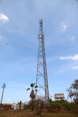 Mobile phone communication tower transmission signal with blue sky and antenna