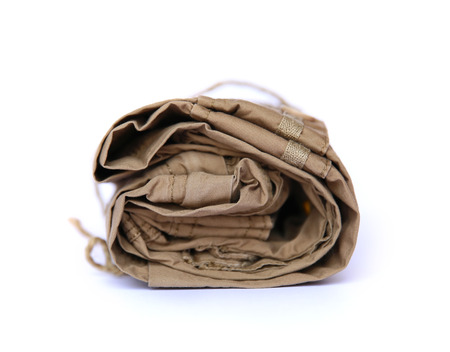trouser legs: Closeup of folded trousers, clothes on a white background