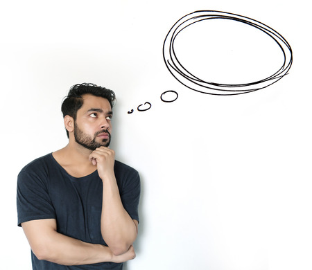 Young Indian Man thinking of thought bubble on white Background photo