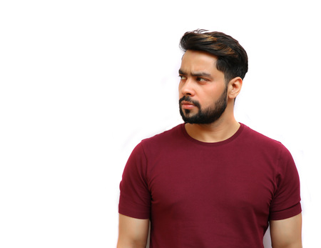 Portrait of an attractive young Indian man with beard looking away. photo