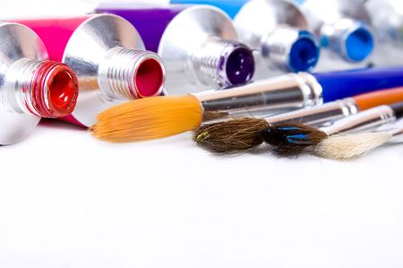 craft supplies: tube of pain with paintbrush Stock Photo