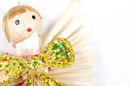 straw christmas angel on white background photo