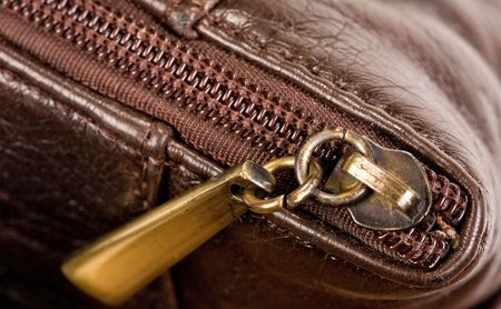 zip on brown leather bag photo