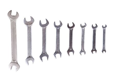 silver spanner on white background photo