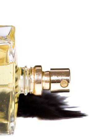 parfum: bottle of parfum with black feather on white background Stock Photo