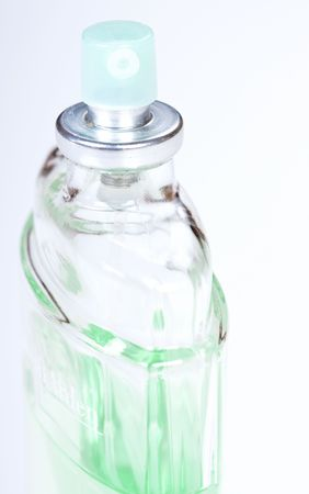 parfum: green bottle of parfum on white background Stock Photo