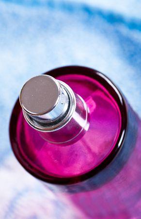 parfum: bottle of parfum on blue background Stock Photo