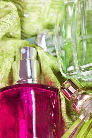 parfum: bottle of parfum on green background Stock Photo
