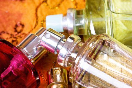 parfum: bottle of parfum on orange background Stock Photo