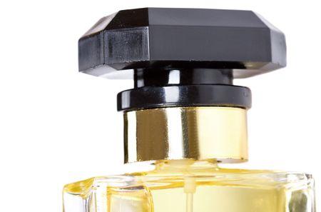 parfum: yellow bottle of parfum on white background