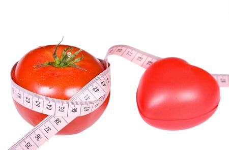 red tomato with pink measure photo