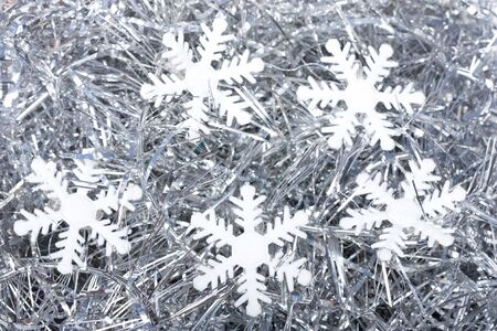silver background: snow flakes on silver background Stock Photo