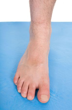 anklebone: male foot on blue mat Stock Photo