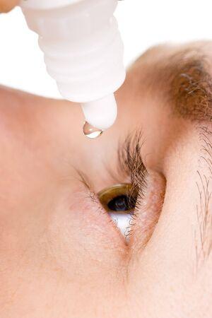 man sick with eye drops  Stock Photo