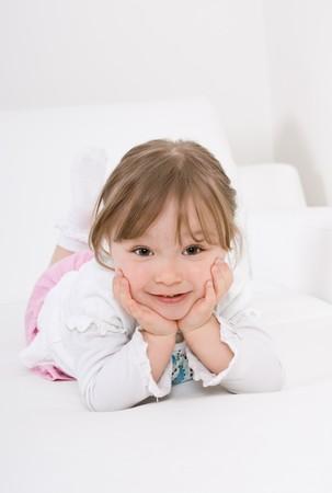 happy little girl on sofa