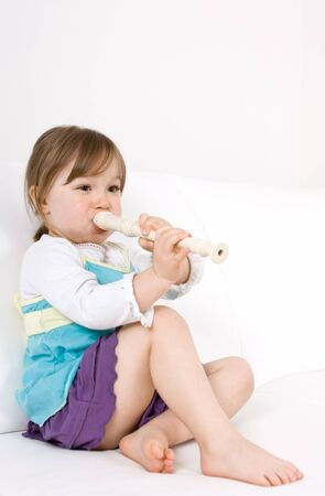 happy little girl with instrument Stock Photo - 7067222