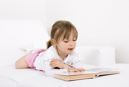 happy little girl reading book Stock Photo - 7067218