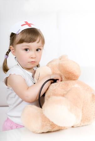 little girl doctor with teddy bear Stock Photo - 7284490