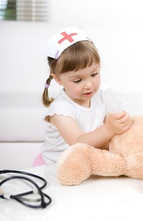 little girl doctor with teddy bear Stock Photo - 7284446