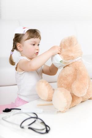 little girl doctor with teddy bear