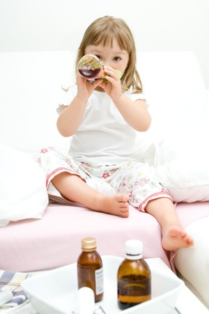 sniffles: sick litttle girl  on bed
