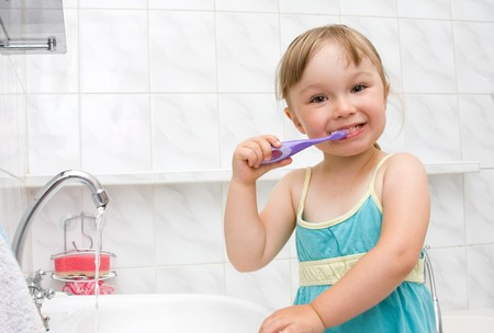 happy little girl in toilet Stock Photo - 7462626