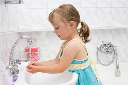 happy little girl in toilet Stock Photo