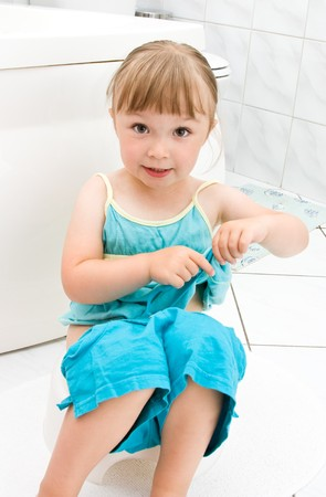 happy little girl in toilet Stock Photo - 7462664