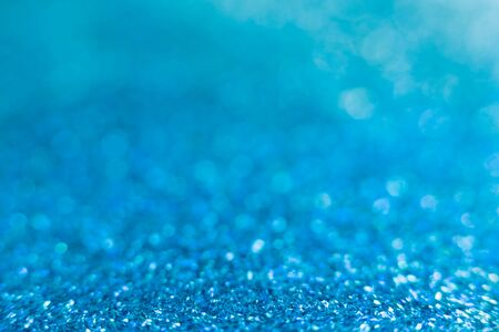 Blue sparkle glitter from diamond dust falling on the floor. Have a lot of bokeh in very soft blur light Stock Photo
