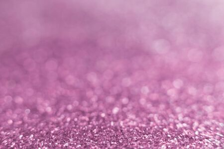 Pink pastel sparkle glitter from diamond dust falling on the floor. Have a lot of bokeh in very soft blur light Stock Photo