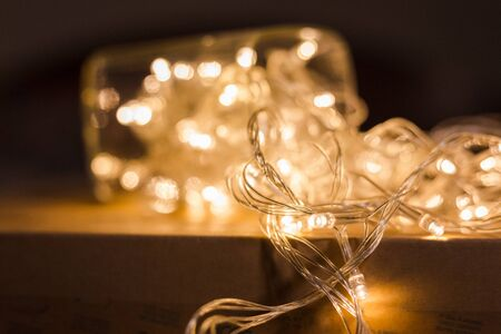 blurred LED light bulb wire with bokeh on paper box