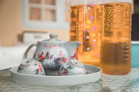 Chinese tea pot with small cup on tray, prepare for serve to quest. Have Chinese character on it mean wish success quickly