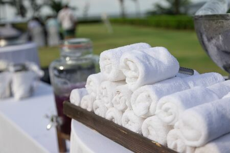 group of refreshing towel for giving to quest in the event in afternoon time at green grass park 写真素材