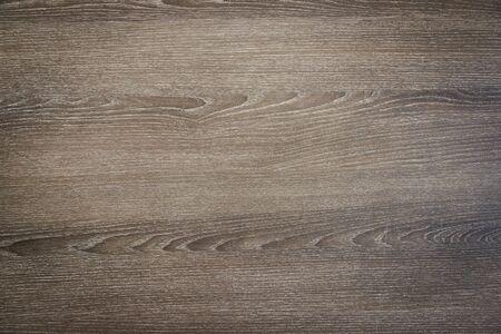 Holztischmuster-Design, es sieht grau und braun mit einigen Kratzern aus