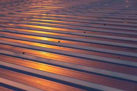 metalic roof pattern with some dirty stain, have yellow light shine on at night time - more dark
