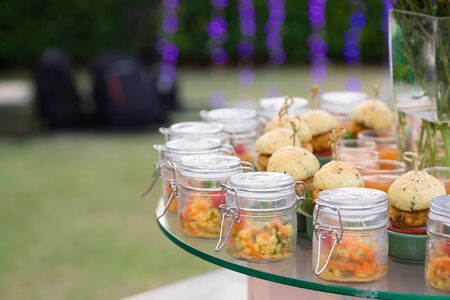 indian food buffet for party put on big glass plate to let guest take them