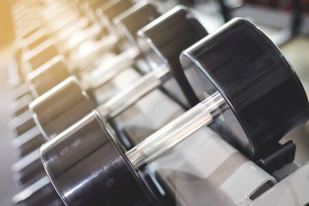 Dumbbell put on the shelves in the fitness center, with some dust on it Stock Photo