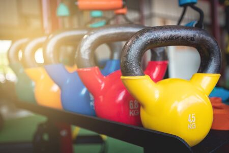 kettlebell for training with many scale of weight on the shelves in fitness center Stock Photo