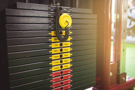 Weight scale of  Weightlifting plate of the training machine in the fitness center