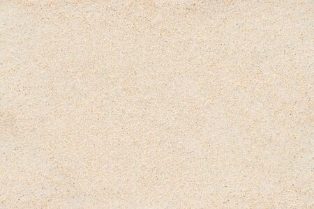 Sable jaune doux sur la plage pour la texture