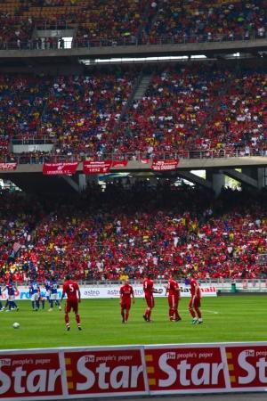 KUALA LUMPUR - JULY 16 : Over 80,000 Malaysian Kopites are watching Malaysia vs Liverpool Asian Tour 2011 at Bukit Jalil National Stadium on July 16, 2011 in Kuala Lumpur, Malaysia.