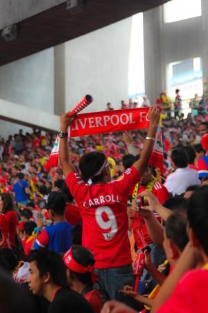 KUALA LUMPUR - JULY 16 : Supporters watch the football game of Malaysia vs Liverpool Asian Tour 2011 at Bukit Jalil National Stadium on July 16, 2011 in Kuala Lumpur, Malaysia.