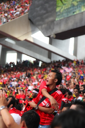 KUALA LUMPUR - JULY 16 : Supporters cheer during the football game of Malaysia vs Liverpool Asian Tour 2011 at Bukit Jalil National Stadium on July 16, 2011 in Kuala Lumpur, Malaysia.